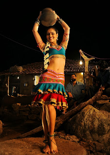Nathalia Kaur in Tight Deep Neck Choli and Ghagra in an Item Song from movie Addirabanna