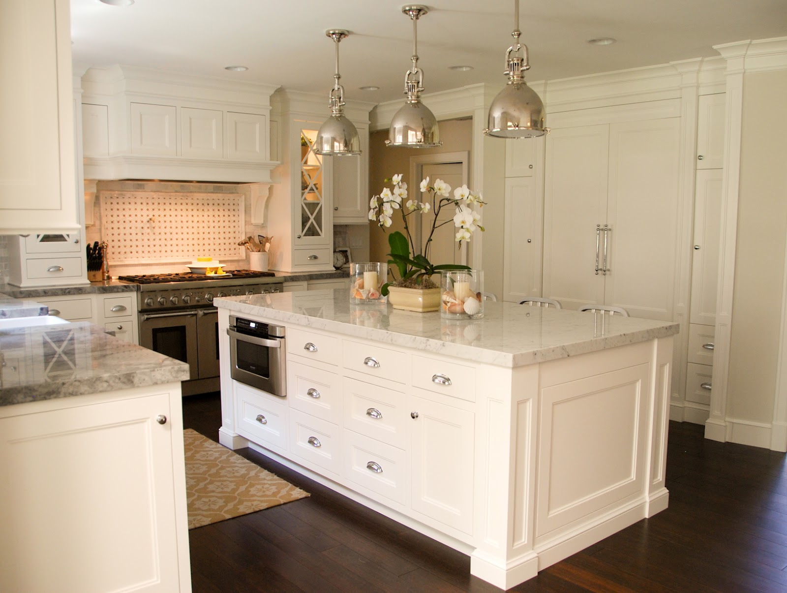 The granite gurus carrara marble super white quartzite for White kitchen cabinets with white marble countertops