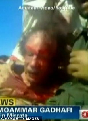 sumber pict http://www.dailymail.co.uk/news/article-2051361/GADDAFI