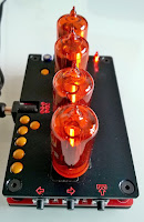 Nixie tube clock, amber red, side