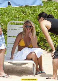 Britney Spears caught in Hawaii lounging & tanning in a yellow bikini