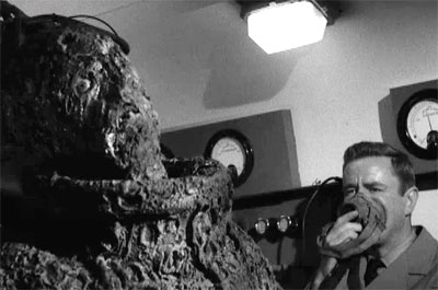 In addition to portraying the pre-crusty test pilot, actor Bill Edwards suited up as the monster