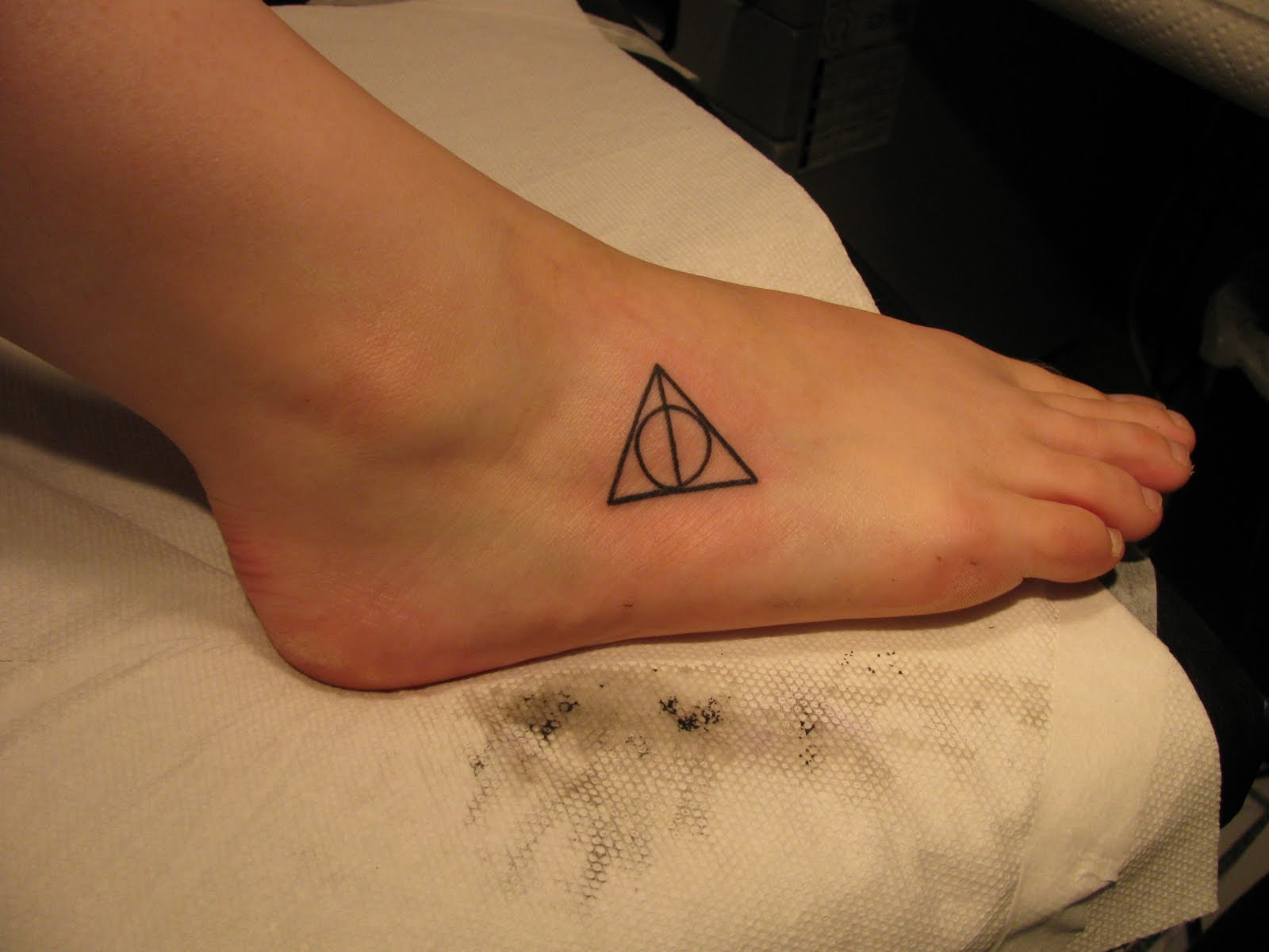 Deathly Hallows foot tattoo | A Very Potter Board | Pinterest