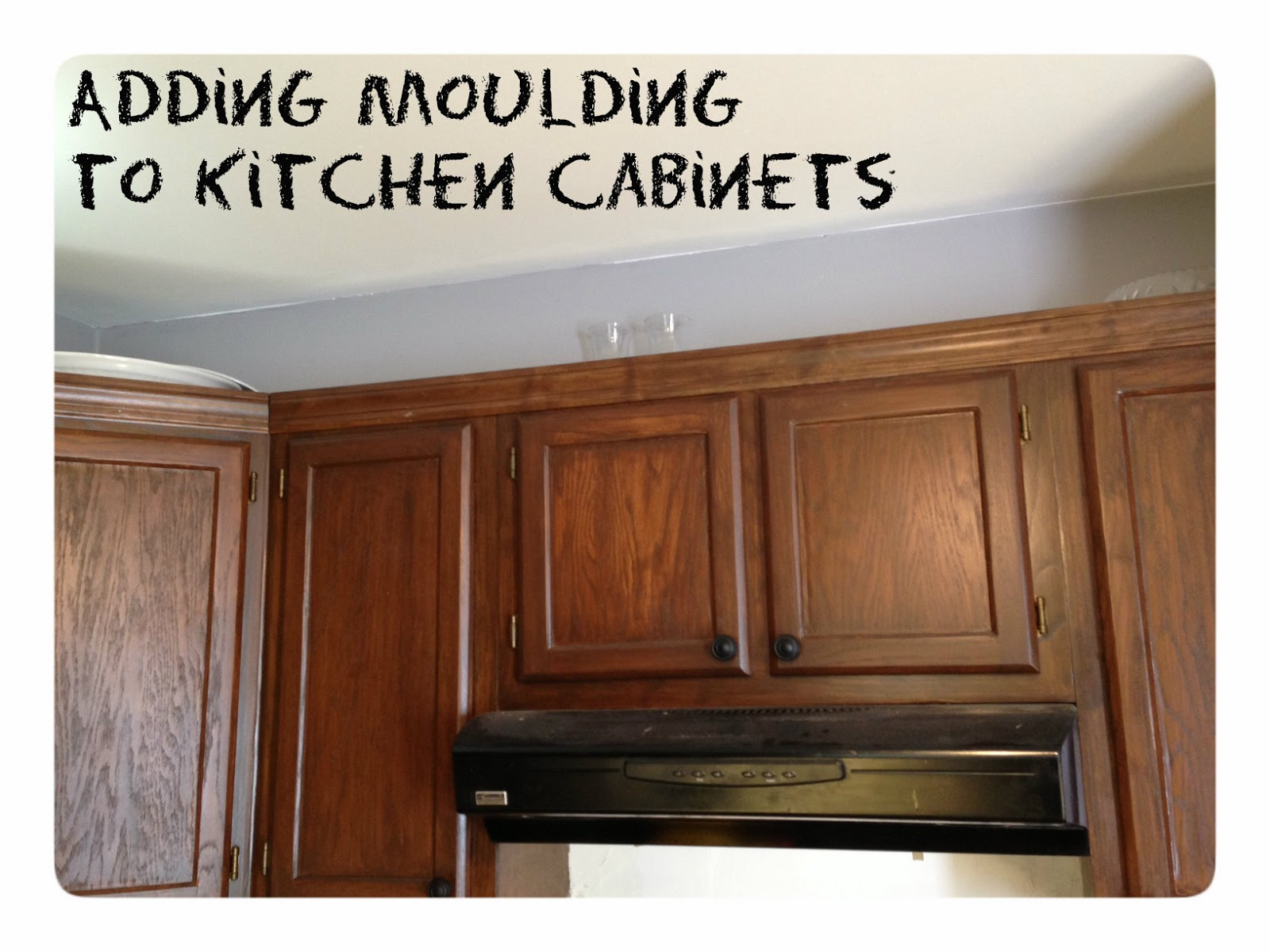 adding moulding to the cabinets