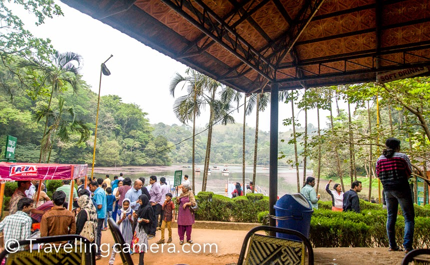 Wayanad region in Kerala has lot to offer and 10 days trip is not enough to explore this part of the country. After beautiful walk around Banasura Sagar dam, we headed towards Pookode lake. Pookode Lake is located 15 kilometers away from Kalpetta. This Photo Journey shares some of the moments spent around Pookode lake in Waynad district.It's again a well regulated tourist spot, which has a dedicated entry and a counter for buying tockets & security check. I think entry ticket to Pookode lake was 40 rs per person. The lake is under the South Wayanad forest division and run by District Tourism promotion council. Boating facilities, children's park, handicrafts and spices emporium and fresh water aquarium are among the tourist attractions here.There is a huge space dedicated as kids area. It seems that lot of local folks come to Pookode lake for picnics. Nicely maintained and clean spaces. This kids' zone is facing Pookode lake. On the left hand side, there are few shops selling different types of snacks.We chose a place to sit and have snacks, from where who lake was visible. Above photograph is clicked from same place. It was good to see most of the folks using dustbins for throwing the remains. And authorities had put appropriate number of dustbins around Pookode lake.Pookode lake has lot of lotuses and the lake looks beautiful from the other side. Pookode Lake is a scenic freshwater lake in the Wayanad  district in Kerala, South India. Pookode lake is a natural fresh water lake is surrounded by green forest from on all sides. This forest is spread over high mountains around the lake. All this setting makes it a beautiful place to spend some quality time in peace. Are you wondering about peace at touristic place? :)Pookode lake is spread across an area of approximately 8 hectares and with a maximum depth of 6.5 metres. Lake is 3 km from Vythiri town and is one of the most popular tourist spots in Wayanad.There is a path built around the lake and people prefer to wal