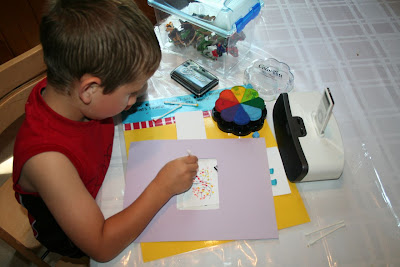 Boy doing craft, listening to ipod: STEMmom.org