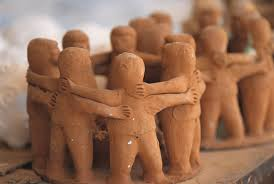 Group of clay figures hugging