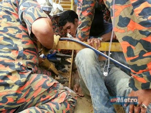 Lelaki menderita tangan tersepit lebih sejam dalam mesin
