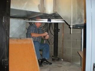 Bill, N9RI under the HVAC air handlers preparing the coax ends