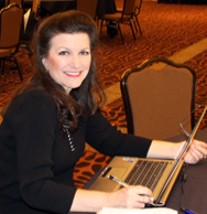 Barbara using her computer at the April 2012 Symposium for CTU in Colorado Springs