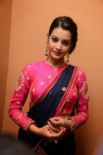 Deeksha Panth in Black Saree Pink Blouse at Kavvintha Movie Audio Release
