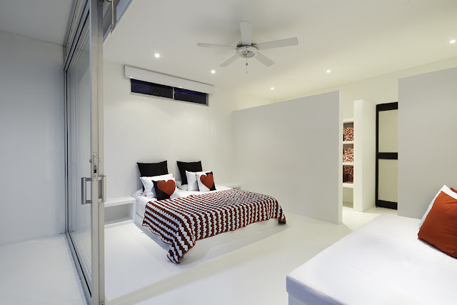 Minimal master bedroom with large bed