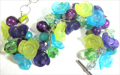 Chunky bracelet has purple and green flowers with dragon veins agate, aquamarine and crackle beads