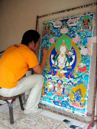 artist creating thangkas