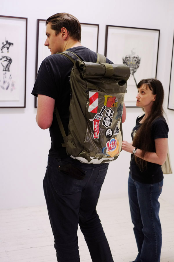 Karki hiking backpack with groovy stickers on clear plastic. A Study of Hands Friday, October 26 at 6:00pm at China Heights