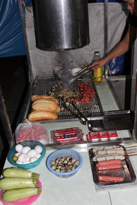 Grilled food at night in Bát Xát town