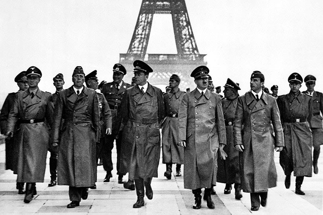 Adolf Hitler with other German officials walking in front of the Eiffel Tower in Paris, 1940.