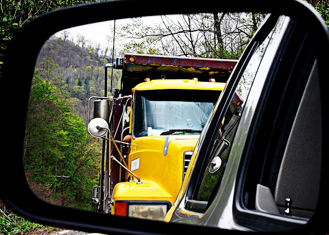 WV photographer yellow truck rearview mirror