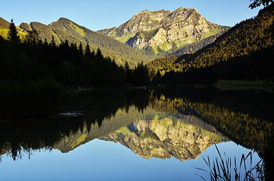Image of Roc d'Enfer mountain reflected in Vallon lake
