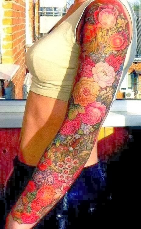 Handsome Sleeve flowers Tattoo.