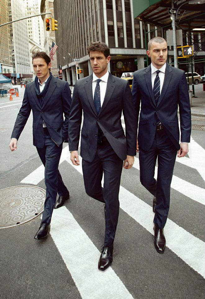 Men in Well Tailored Suits