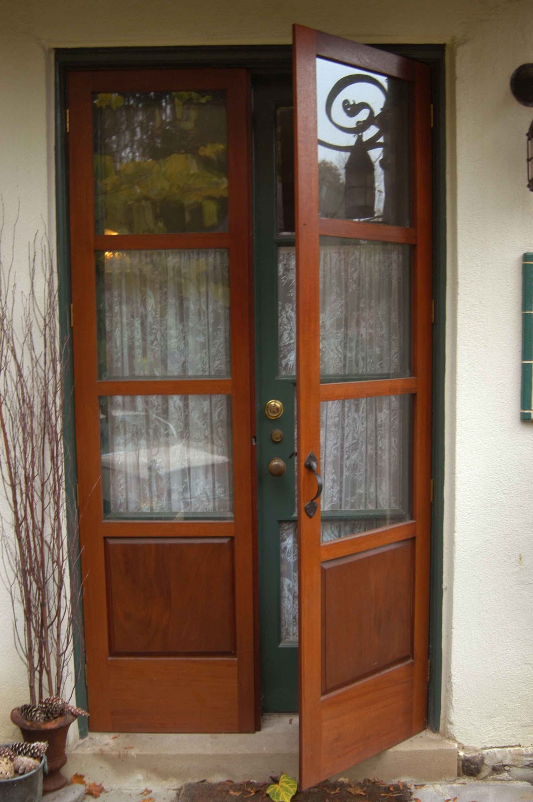 Our french inspired home exterior french doors which for Wooden french doors