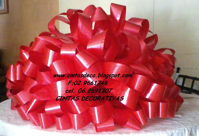 Cintas decorativas mo os decorativos para autos de regalo - Como hacer lazos decorativos ...