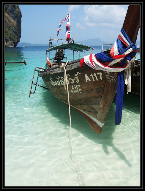clear water and longboats thailand