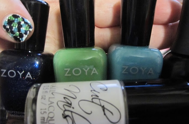 Bottle shot:  Zoya Indigo, Josie, and Rocky, Finger Paints Black Expressionism, and Cult Nails Tempest.