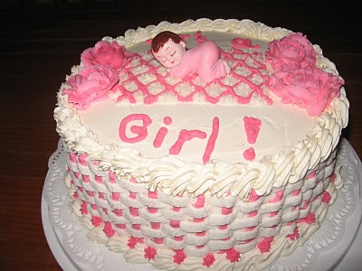 Baby shower cake with note of the baby sex on top of its surface