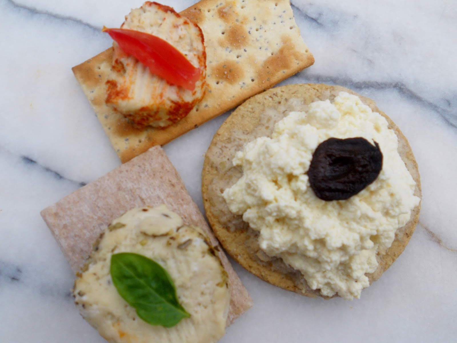 cheese with smoked paprika on seed cracker with tomato, tofu cheese ...