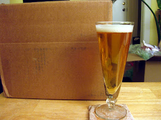 Rye saison next to a box of hops.