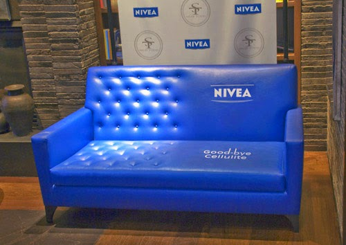 Propaganda NIVEA sofá Good-bye cellulite