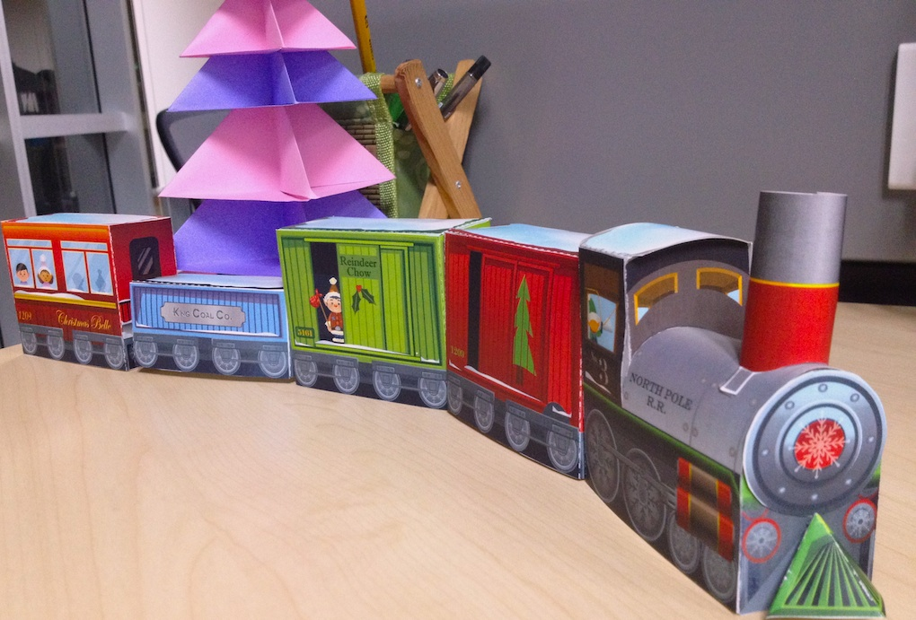 Colorful train in it take a look on a 3d cardboard christmas train
