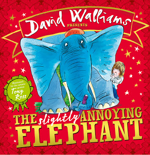 Front cover of The slightly annoying Elephant by David Walliams showing a big blue elephant and a small boy hiding behind his leg