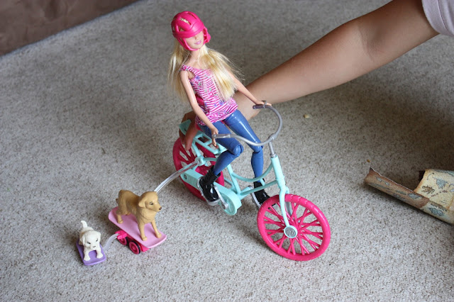 Barbie Spin 'n Ride doll with puppies