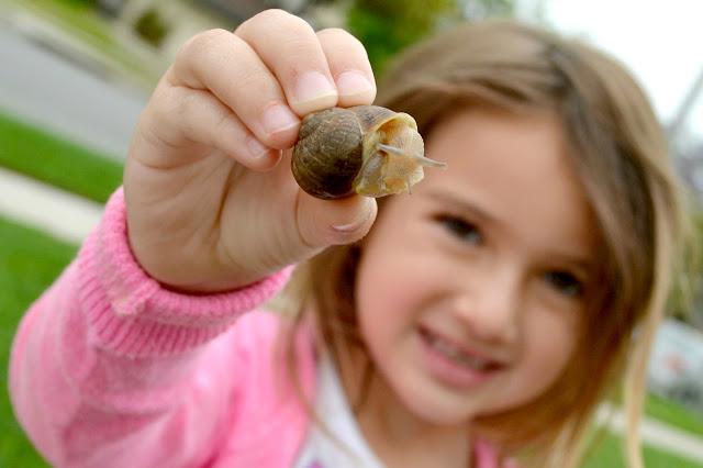 girl holding a snail