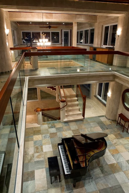 Bridges and piano in an Impressive Waterfall House in Hawaii