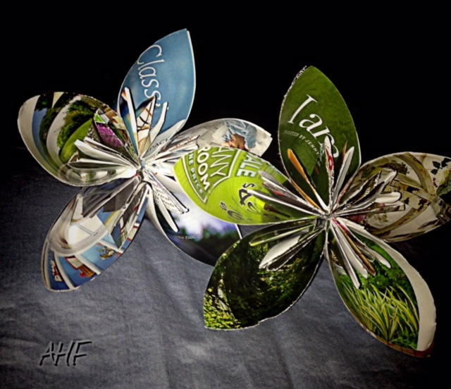 Rolling magazine pages creating art recycled paper pendants i decided to show more paper flowers they are certainly not trying to compete with nature but i am amazed what one can do with a simple pun intended mightylinksfo