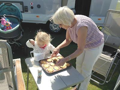 Tin Box Tot decorating cakes with grandma