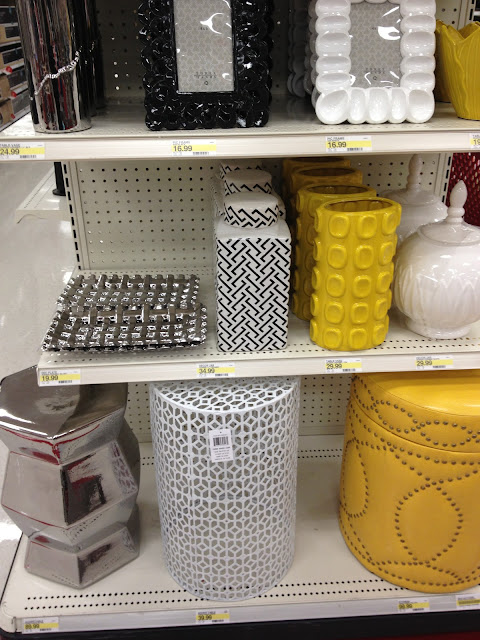 yellow Target nail head stool and black and white containers