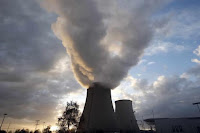 Steam rises at sunset from the cooling towers of the Electricite de France (EDF) nuclear power station at Nogent-Sur-Seine, France, November 13, 2015. (Credit: Reuters/Charles Platiau)  Click to Enlarge.