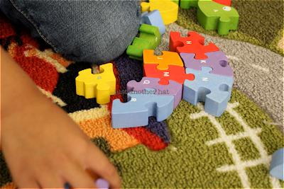 dinosaur wooden puzzle pieces
