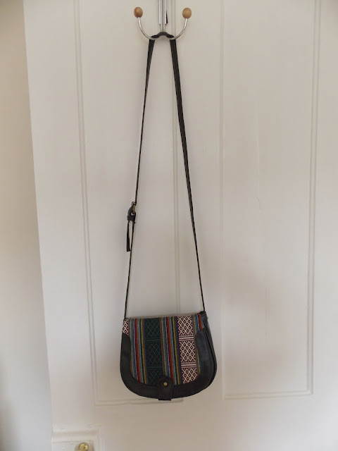 Black cross-body bag with Aztec/tribal design
