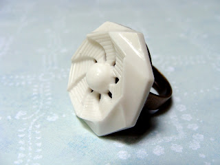 white vintage button ring jewelry with swirling geometric design