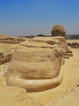 Rare view of Great Sphinx from behind, showing tail, natural limestone, and dressed stone finish