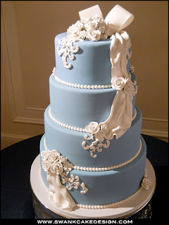 4 tier blue and white wedding cake
