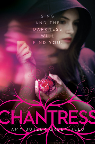 Cover of the novel Chantress, depicting a young woman in a cloak holding a glowing red stone