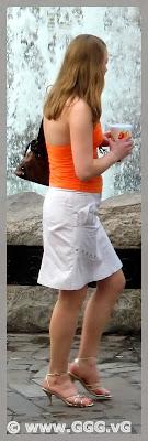 Girl in white skirt on the street