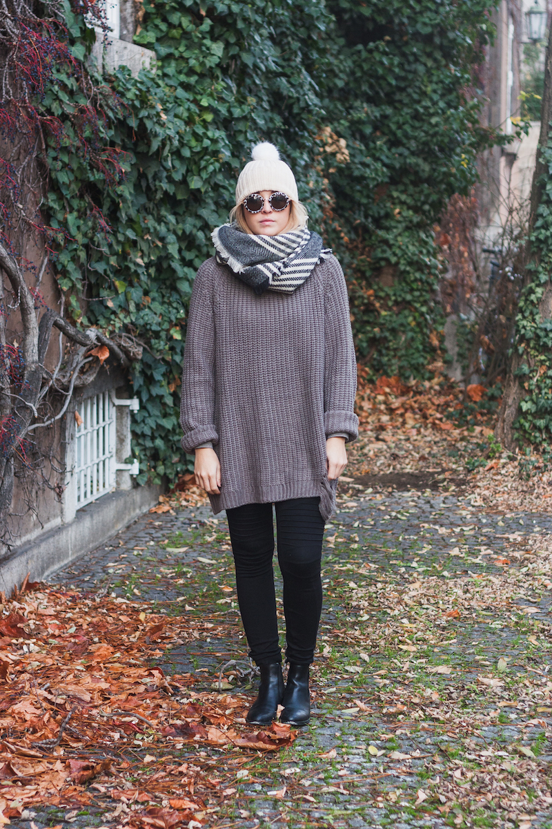 Cold Weather European Travel Essentials & A cozy winter look featuring a blanket scarf and distressed sweater styled by Bryn Newman of Stone Fox Style – How To Wear A Blanket Scarf